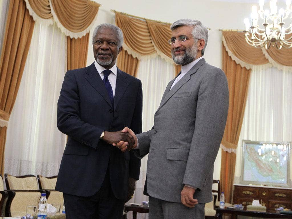 UN and Arab League envoy for the crisis in Syria, Kofi Annan (L) with Iran's chief nuclear negotiator Saeed Jalili in Tehran today