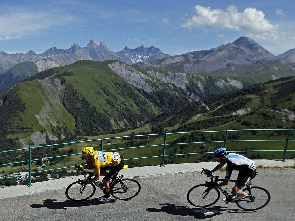 Bradley Wiggins (left) and Chris Froome in the Alps on yesterday's 11th stage