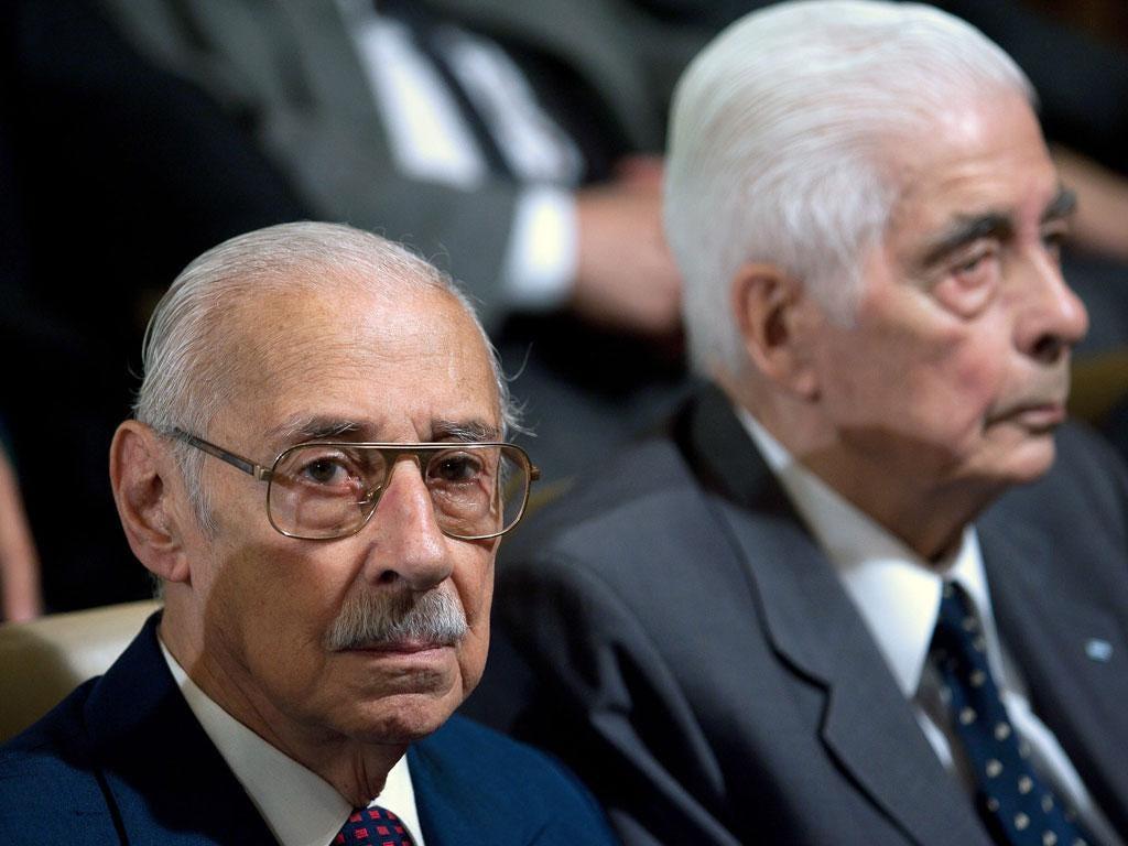 Former Argentine general and dictator (1976-81) Jorge Rafael Videla (left) and former army general Luciano Benjamin Menendezawait