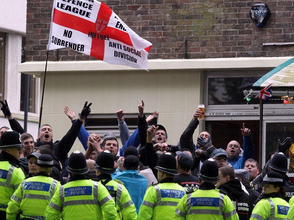 EDL members demonstrate behind police in Bristol today