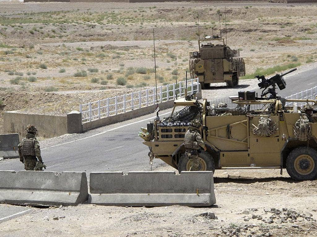 Deployment: British troops at a checkpoint in Afghanistan