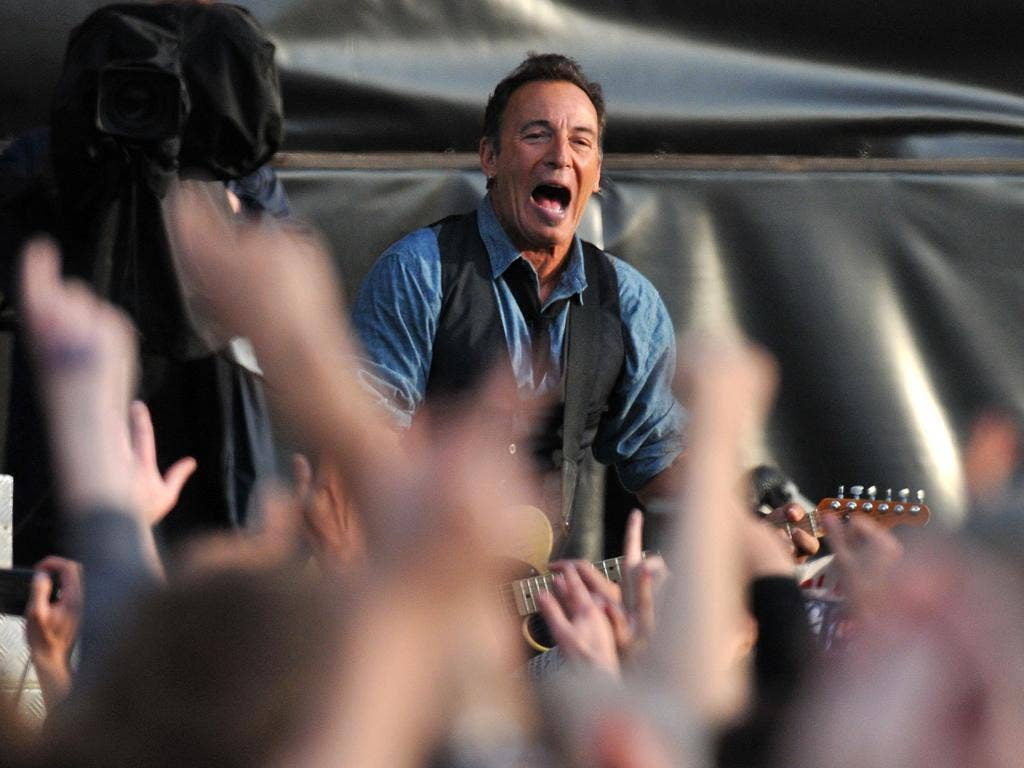 Bruce Springsteen performs live on stage during the second day of Hard Rock Calling at Hyde Park