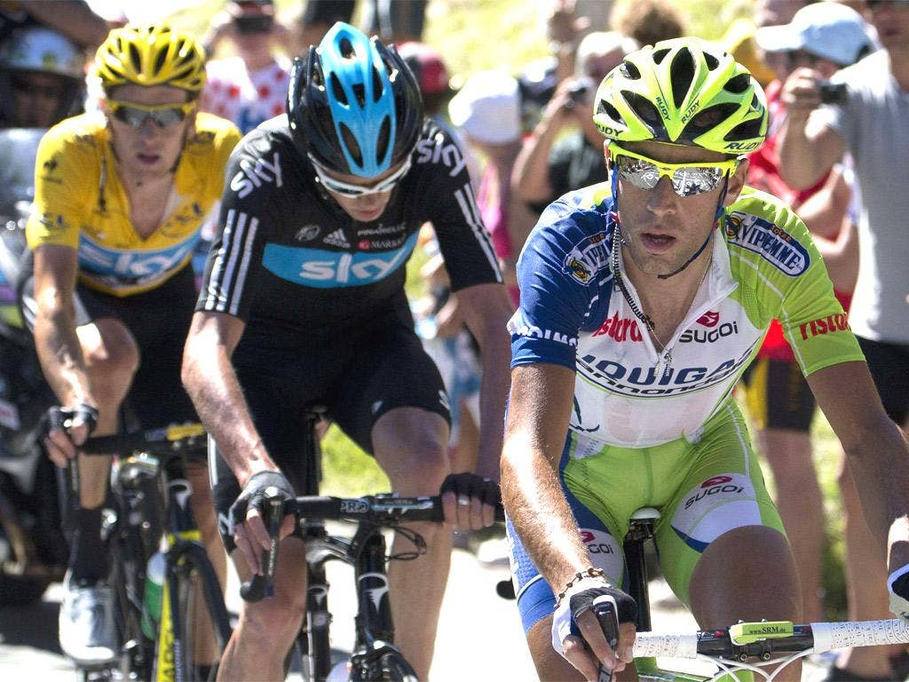 Vincenzo Nibali rides ahead of Chris Froome and Bradley Wiggins