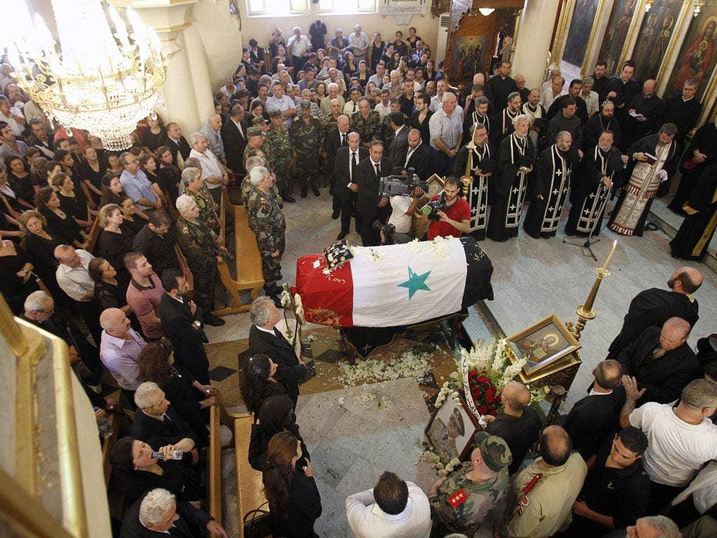 Mourning: The funeral of Syrian Defence Minister, General Daoud Rajha, on Friday