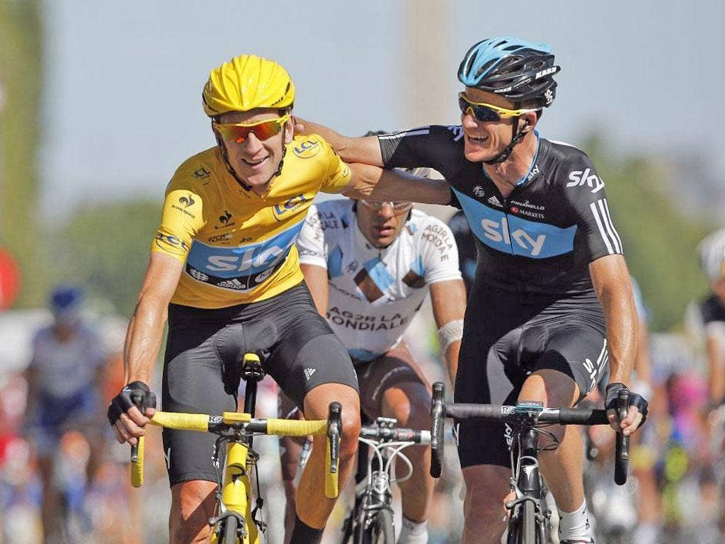 Bradley Wiggins (left) is congratulated by Sky team-mate Michael Rogers after crossing the finishing line in Paris