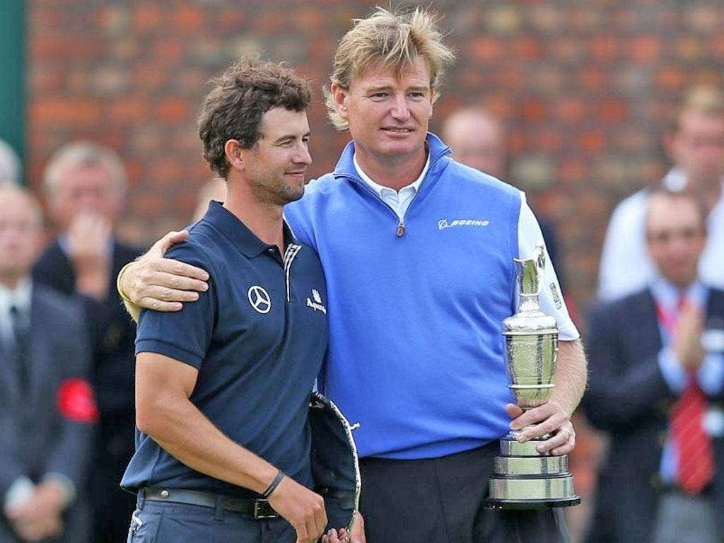 Adam Scott receives a consoling hug from the Open champion Ernie Els after the Australian's Royal Lytham disaster