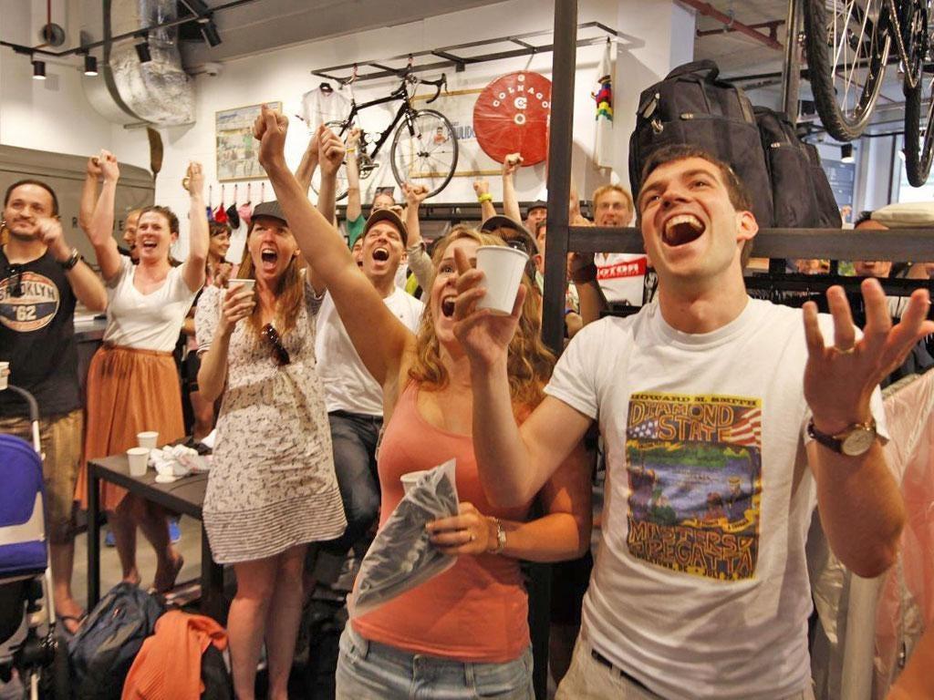 Fans enjoy the end of the Tour de France at the new Rapha café in London