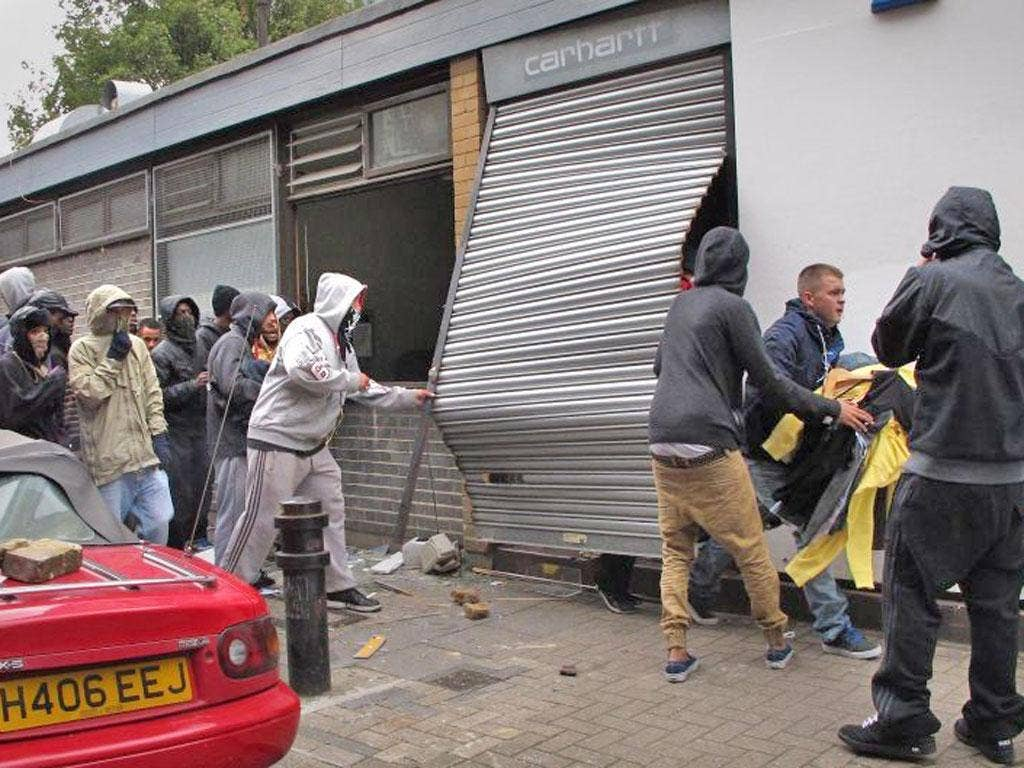 Looters raid a Carhartt store in Hackney during last summer's violence