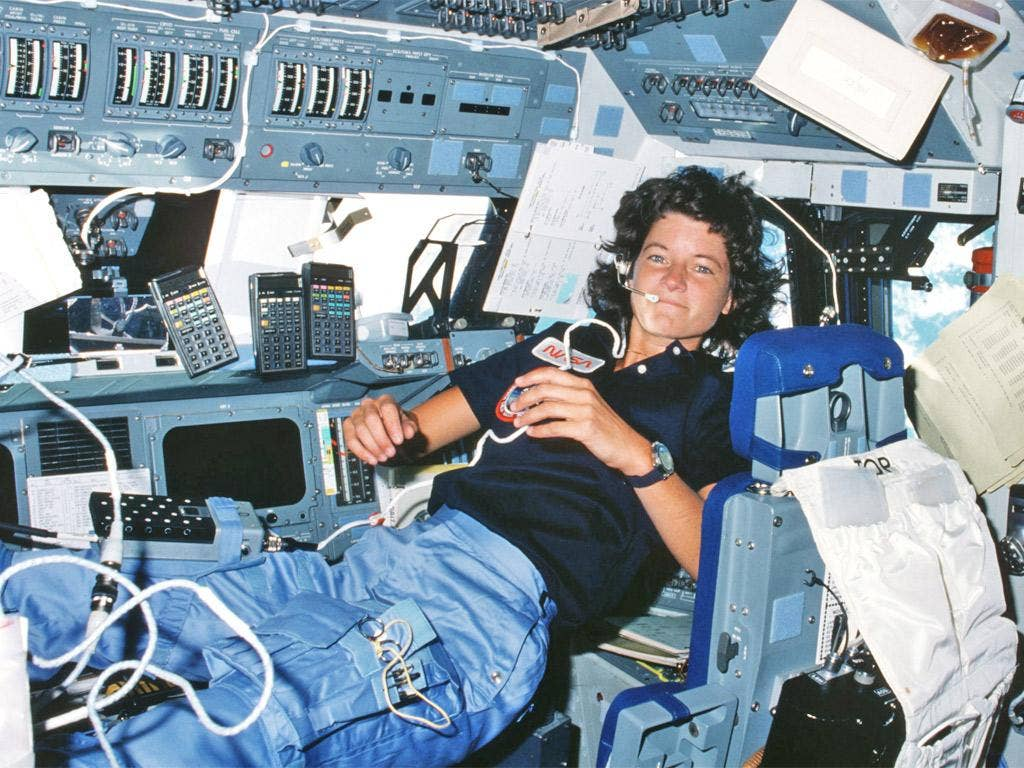 Sally Ride floats weightlessly on the flight deck of Challenger during its second mission in space