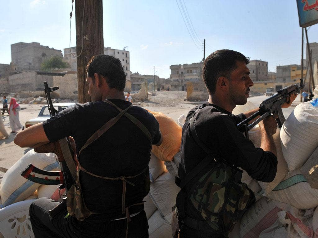 Syrian rebels man a checkpoint in the northern city of Aleppo yesterday
