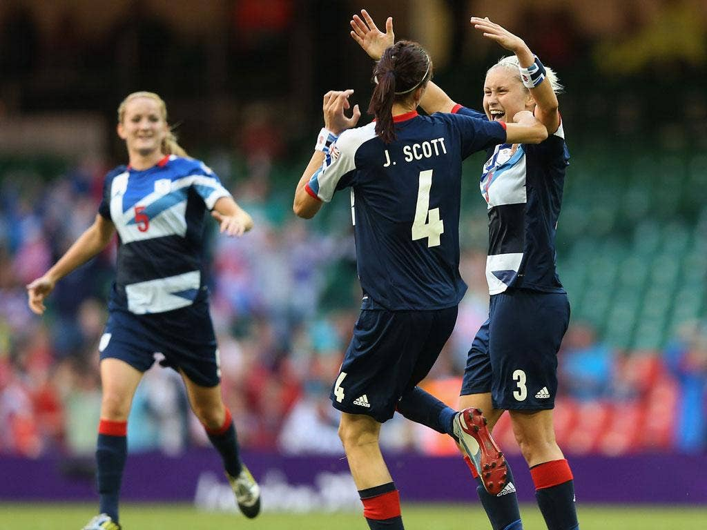 Handy work: Jill Scott celebrates with Steph Houghton after the defender scores Great Britain's third goal