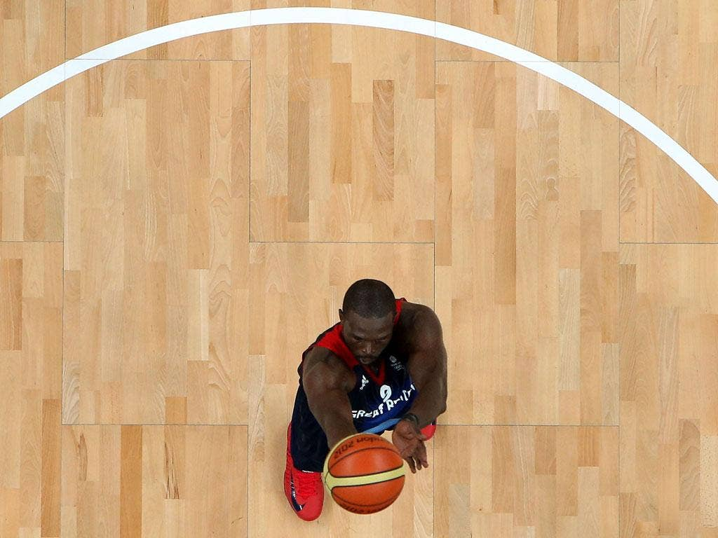 Luol Deng #9 of Great Britain shoots a free throw against Russia