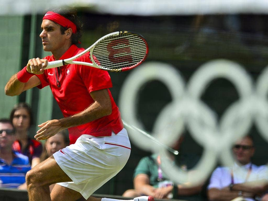 July 30, 2012: Roger Federer in action at Wimbledon