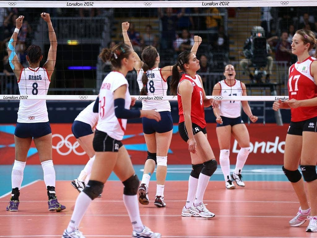 Great Britain players celebrate winning the Women's Volleyball Preliminary match between Great Britain and Algeria