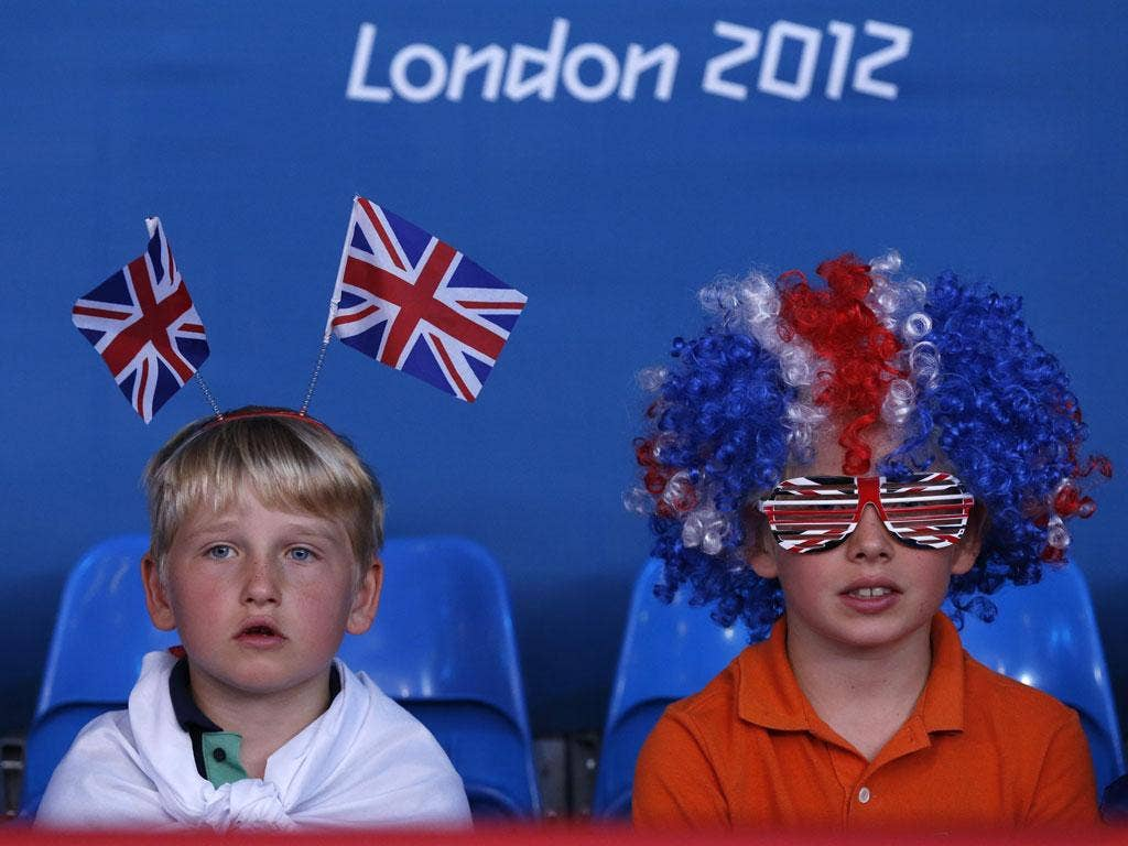 July 31, 2012: Young spectators watch the men's -81kg and women's 63kg judo competition at the London 2012 Olympic Games.