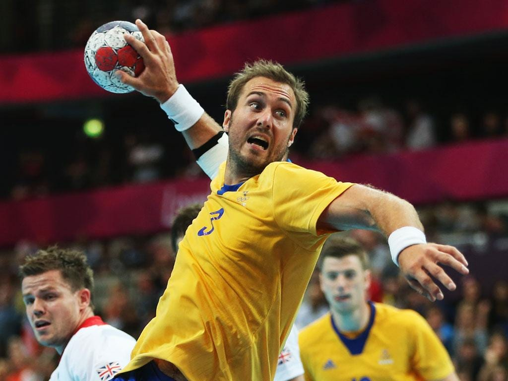 Mattias Gustafsson of Sweden shoots and scores during the Men's Handball Preliminary match between Great Britain and Sweden