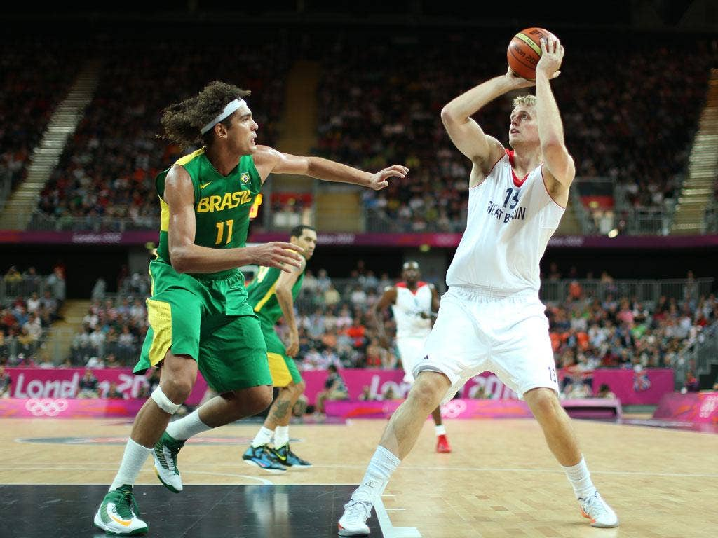 Dan Clark of Great Britain shoots over Anderson Varejao of Brazil in the Men's Basketball