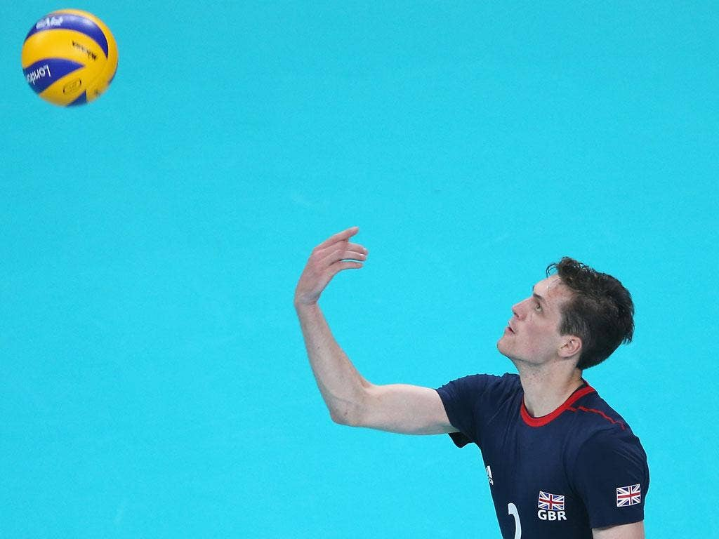 Ben Pipes of Great Britain serves the ball in the third set against Australia
