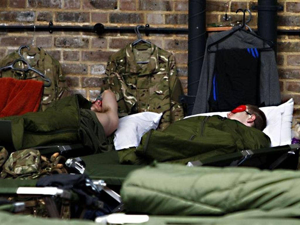 Members of the armed forces at rest at Tobacco Dock as Mayor of London Boris Johnson visited