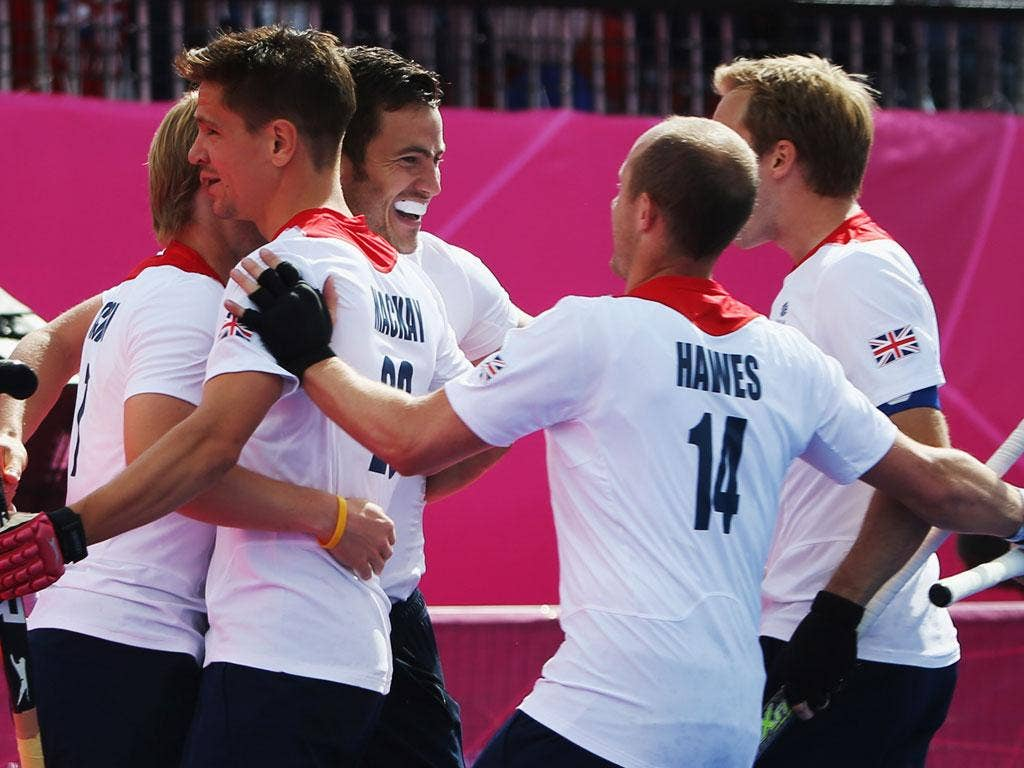 Friday 3, August:  James Tindall of Great Britain celebrates with team mates after his goal during the Men's Hockey match between Great Britain and Pakistan