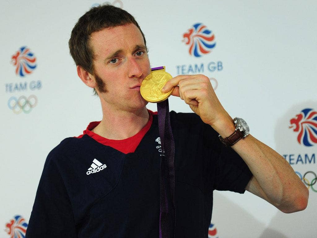 Bradley Wiggins wins gold for the men's individual time trial cycling event on day five of the Olympics