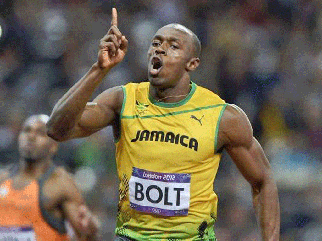 Usain Bolt celebrates his victory in the 100m final