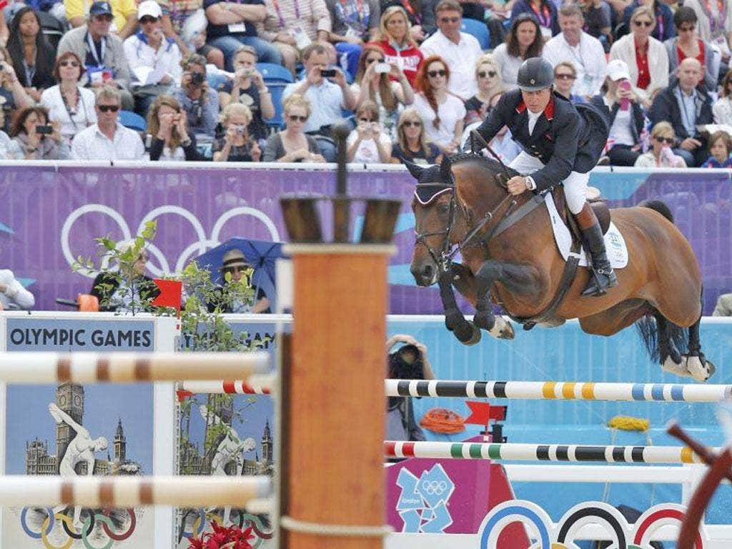 Nick Skelton competes in the jumping at Greenwich Park