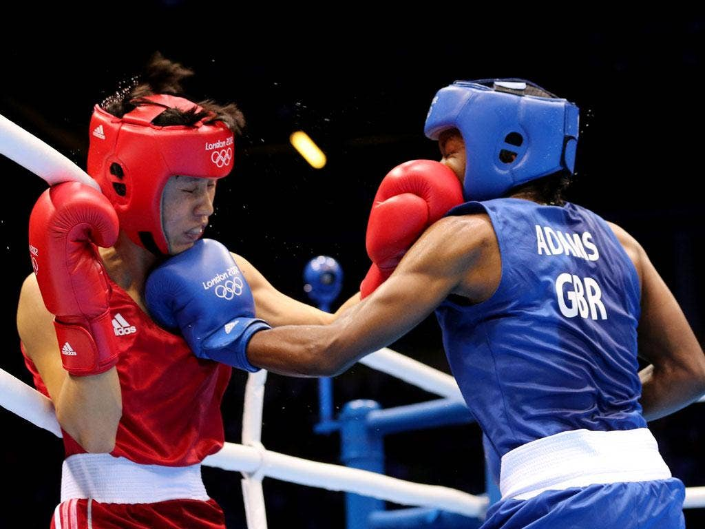 Nicola Adams defeated Cancan Ren of China on Day 13 to win the gold medal in the women's flyweight, and the Olympics' first ever women's boxing gold medal