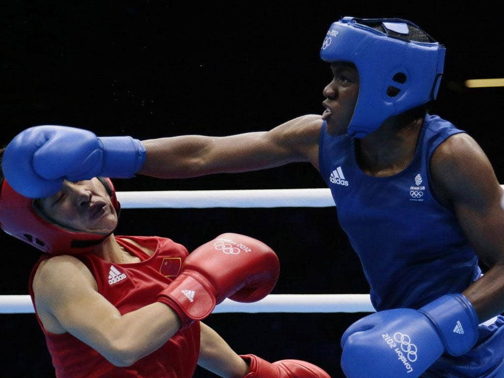 Nicola Adams sends Ren Cancan crashing to the canvas in the -51kg final yesterday