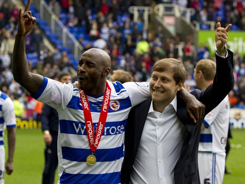 Royal salute: Anton Zingarevich (right) celebrates Reading's Championship title with the talismanic Jason Roberts