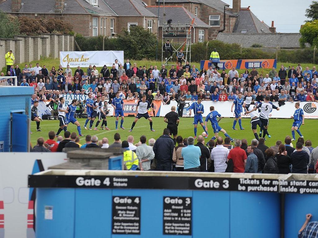 Open house: Rangers begin the new season in the exposed surroundings of Peterhead's Balmoor Stadium
