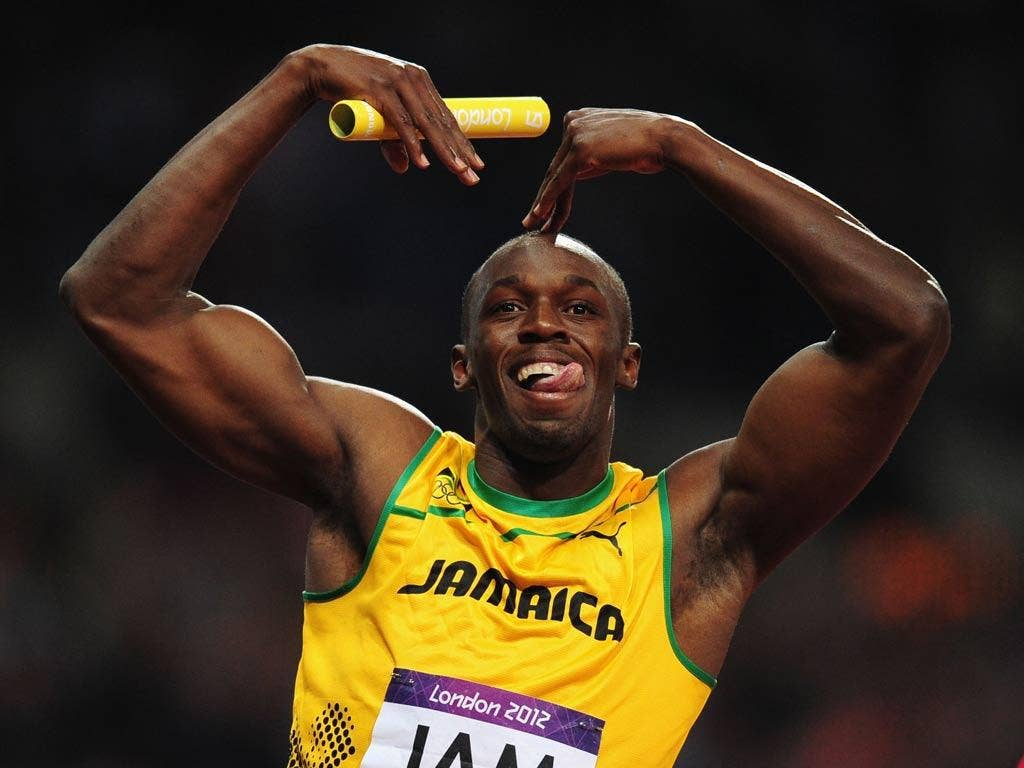 Usain Bolt celebrates gold by doing 'The Mobot'