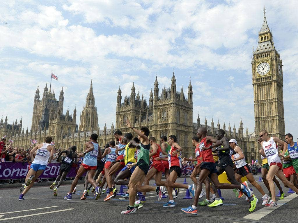 August 12, 2012:  Athletes run in front of Big Ben and the Palace of Westminster during the men's marathon