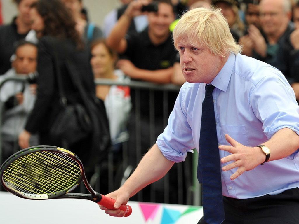 Boris Johnson playing tennis.
