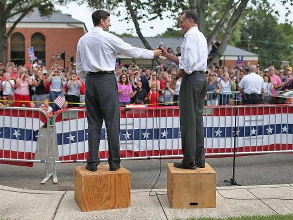 Boxing clever: Paul Ryan, left, and Mitt Romney at a rally in Ashland, Virginia, yesterday. They promise to rebuild America