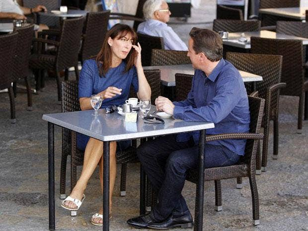 David and Samantha Cameron relax outside a Spanish cafe today