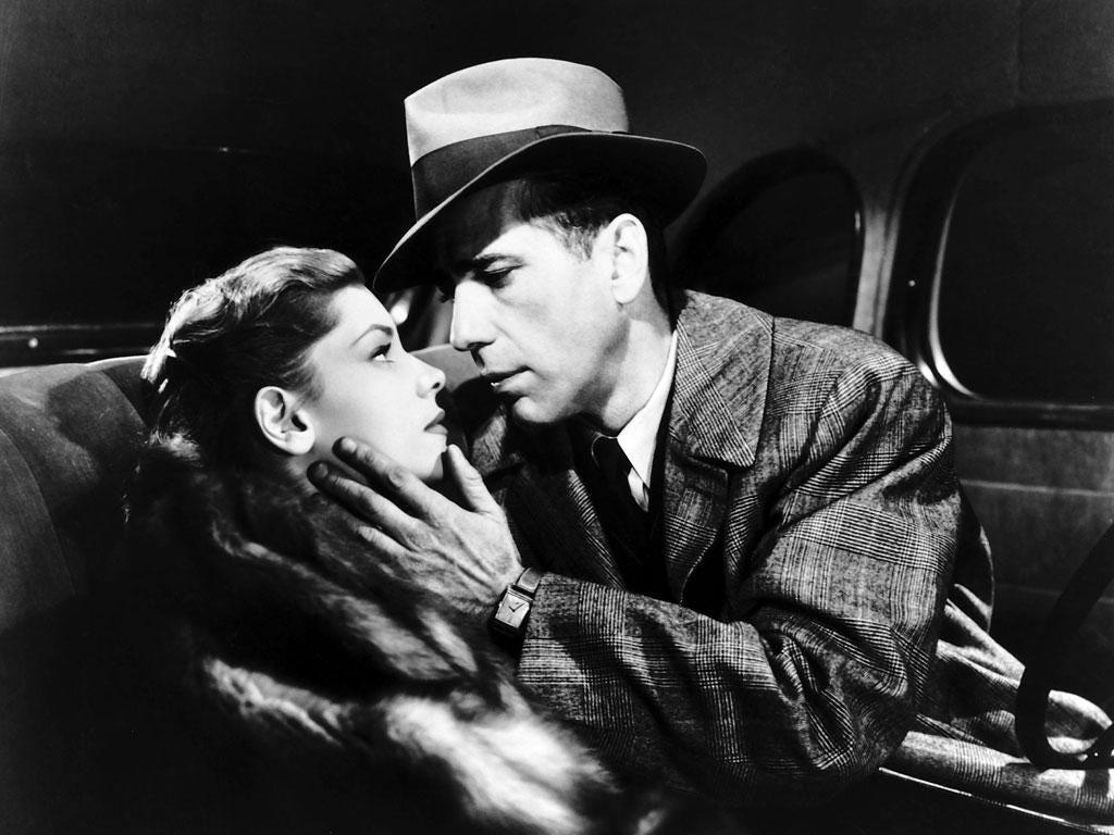 Humphrey Bogart as Philip Marlowe (with Lauren Bacall in The Big Sleep)