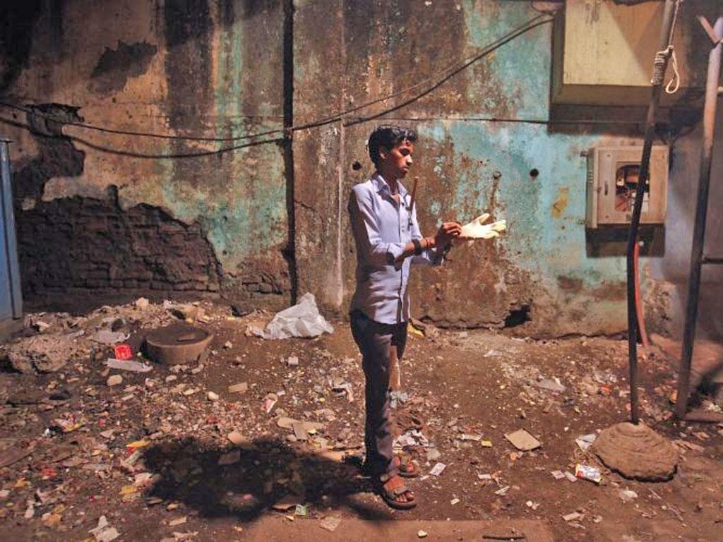Rat killer Shakeel Sheikh, 24, getting ready for work in Mumbai