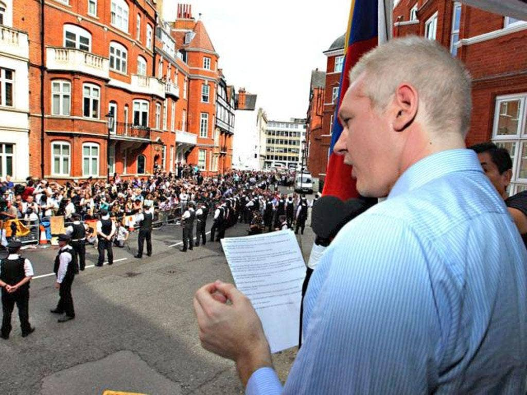 WikiLeaks founder Julian Assange reads his speech from a balcony at the Ecuadorean embassy in central London