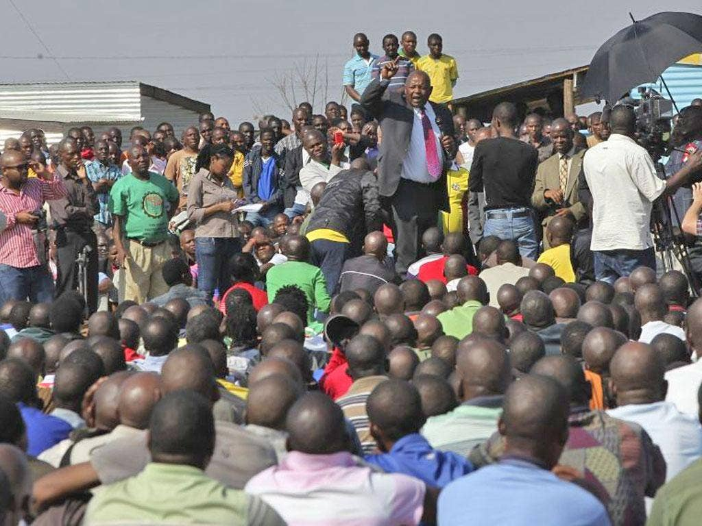 Mosiuoa Lekota of the political party Congress of the People addresses workers at the Marikana mine