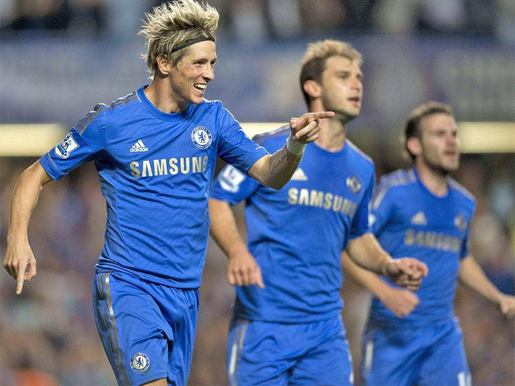 Fernando Torres celebrates scoring Chelsea's third goal