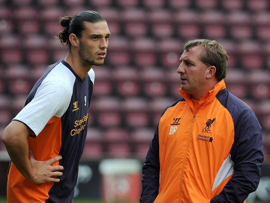 Brendan Rodgers talks with Andy Carroll