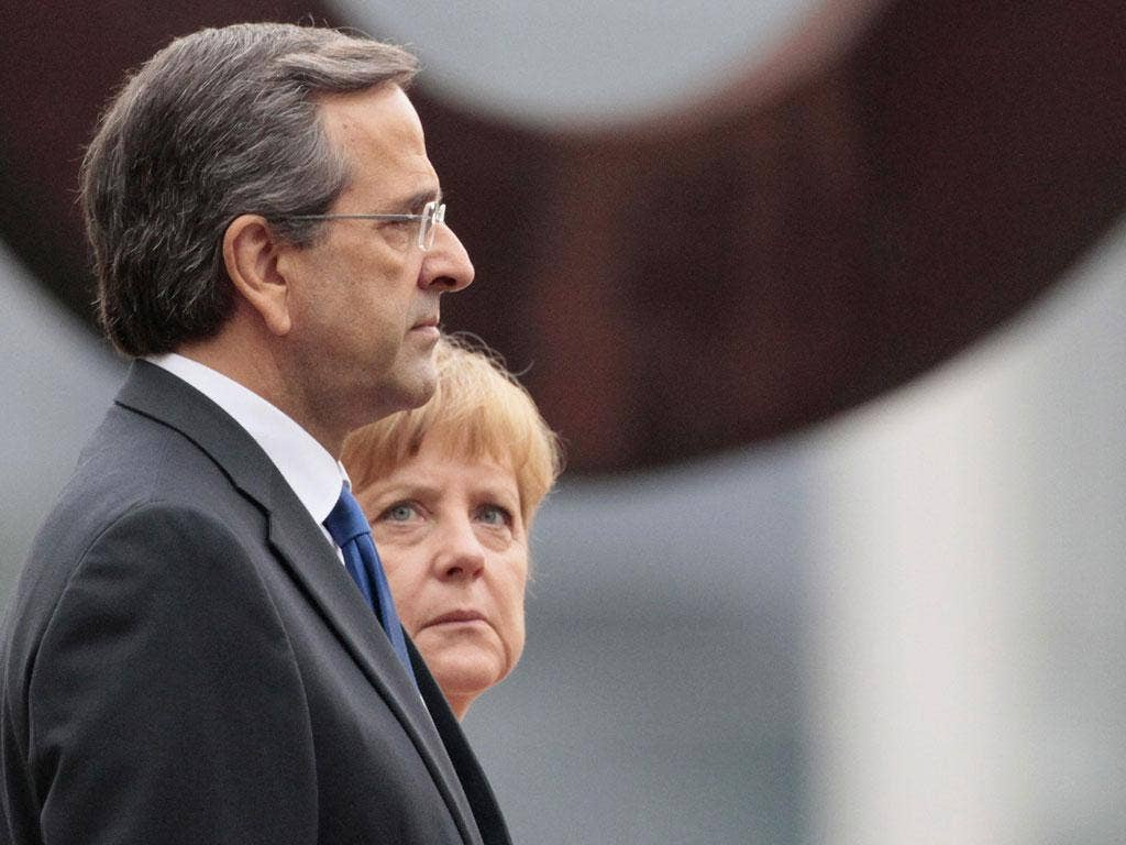 German Chancellor Merkel and Greek Prime Minister Samaras attend a welcome ceremony in Berlin