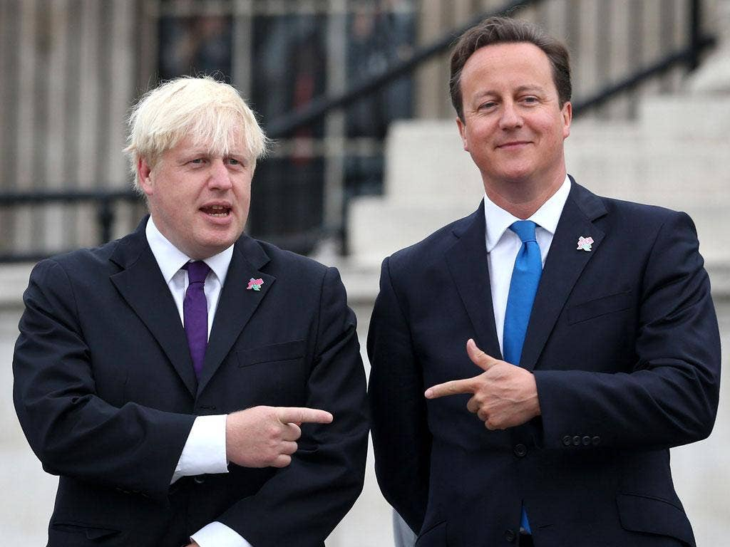 Boris Johnson and David Cameron attend the lighting of the Olympic cauldron in Trafalgar Square ahead of the start of the Paralympic Games