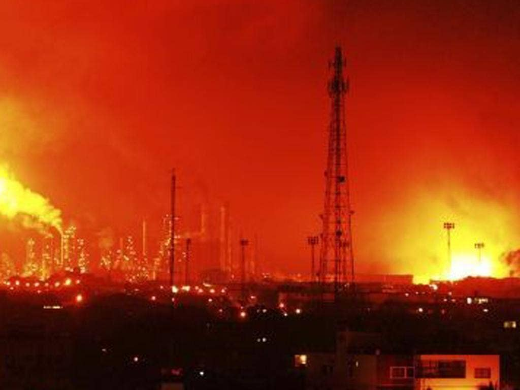 Balls of fire rose over the Amuay refinery, one of the largest in the world, in video posted on the Internet by people who were nearby at the time
