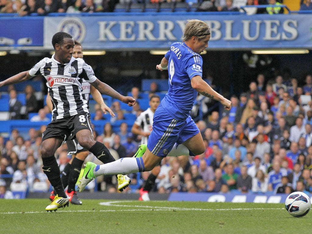 Vurnon Anita brings down Fernando Torres to concede penalty from which Chelsea took lead