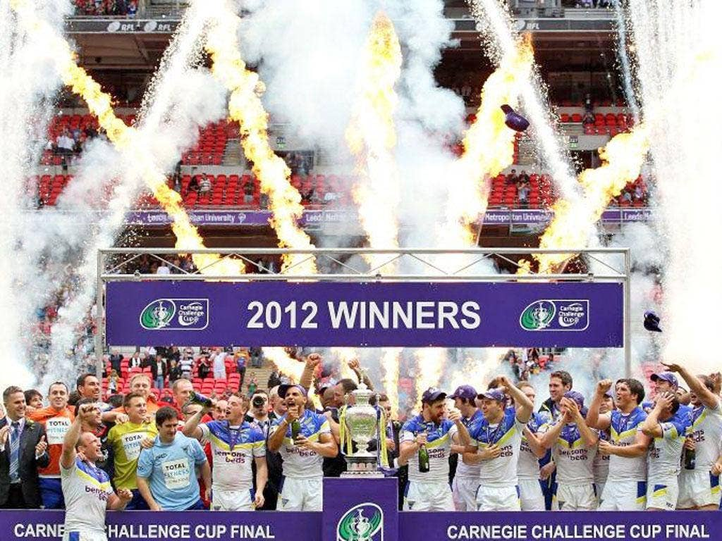 Warrington players celebrate with the Challenge Cup trophy after their victory over Leeds Rhinos in the final at Wembley