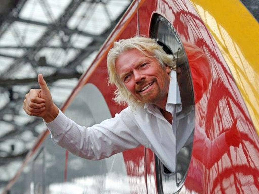 Richard Branson wants the train deal postponed for a month until after the summer holidays
