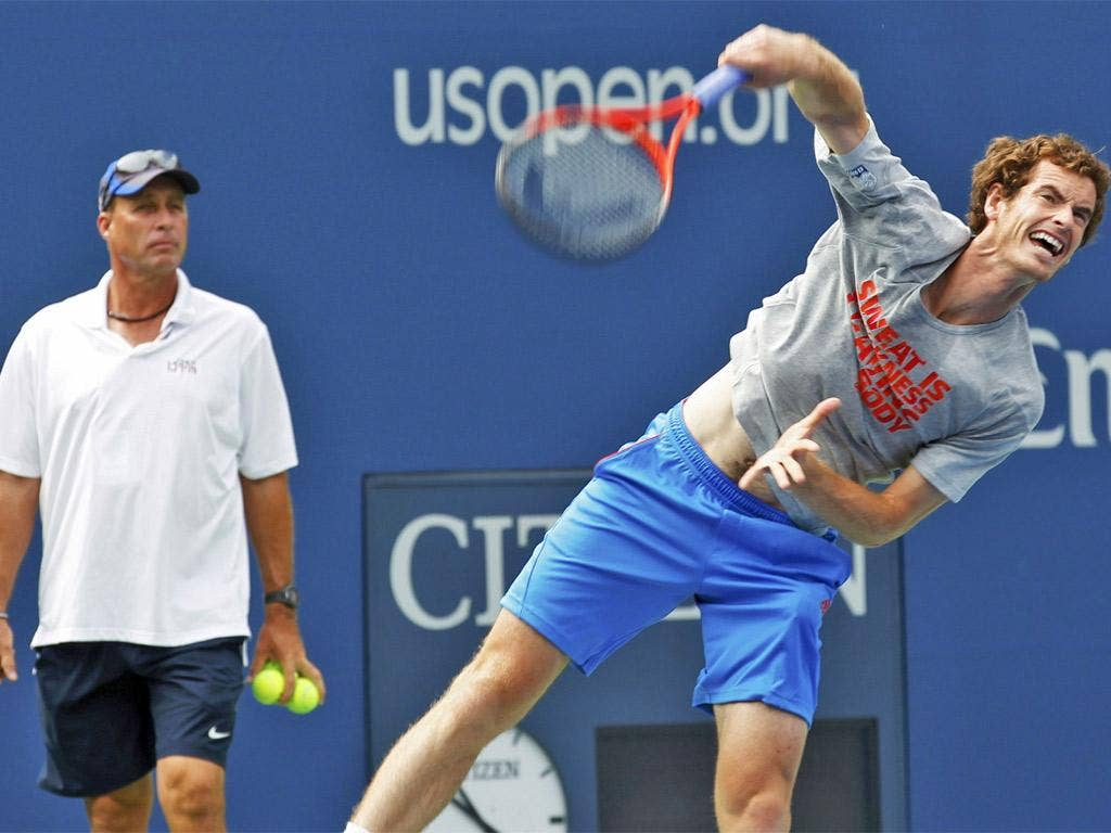 Andy Murray practises watched by his coach Ivan Lendl
