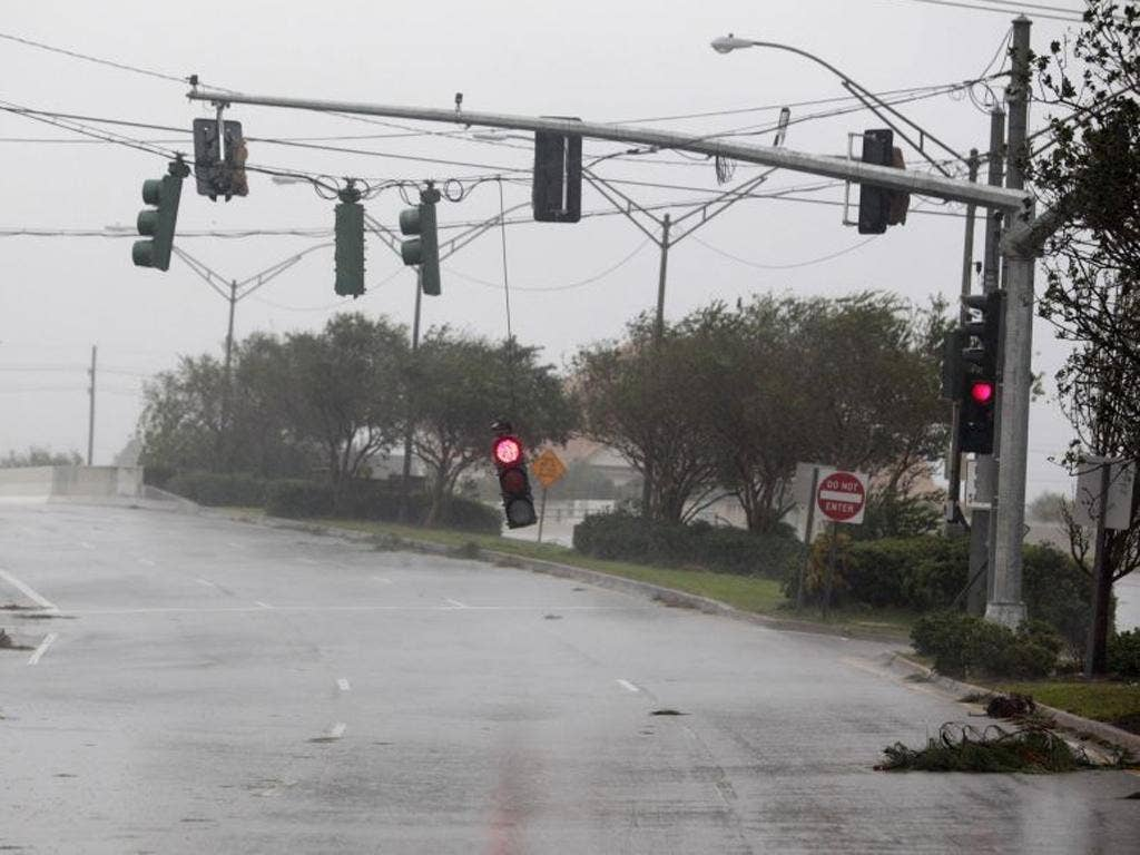 A stop light hangs down during strong wind and rain as Hurricane Isaac pushes into the New Orleans metro area in Metairie
